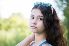 Girl teenager turned looking over shoulder Royalty Free Stock Photos