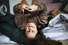 Girl teenager using smartphone on the bed Royalty Free Stock Images