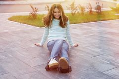 Girl teenager in the wheels of rollers, adapted to sneakers Stock Photography