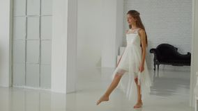 The girl goes forward on the white floor stock video footage