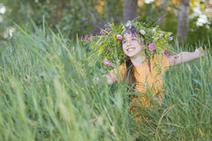 Girl-teenager in a wreath from colors Stock Photos