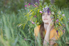 Girl-teenager in wreath. Portrait girl-teenager in wreath from flowers Royalty Free Stock Photography
