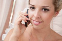 Girl and telephone Royalty Free Stock Photos