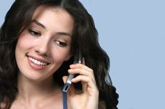 Girl with telephone. White girl with telephone on the blue background stock images