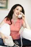 Girl with telephone. On the room royalty free stock image