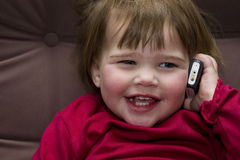 Girl on telephone. Young girl talking on cell phone royalty free stock photography