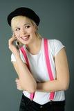 Girl with telephone Stock Photos