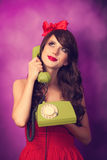 Girl with telephone Royalty Free Stock Photos