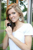 Girl in the telephone booth Royalty Free Stock Photography