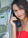 Girl in telephone booth Royalty Free Stock Photography