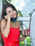 Girl in telephone booth Stock Image