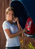Girl in telephone box Royalty Free Stock Image