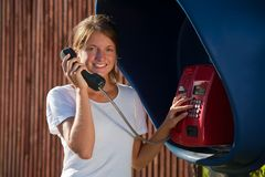 Girl in telephone box outdoo Royalty Free Stock Photography