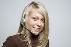 Girl with telephone headset. Close-up of a girl wearing a telephone headset Royalty Free Stock Photo