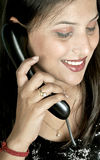 Girl with telephone receiver Royalty Free Stock Image