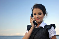 Girl with a telephone receiver in hand Royalty Free Stock Photography
