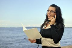 Girl with a telephone receiver in hand Stock Photo