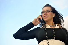 Girl with a telephone receiver in hand Royalty Free Stock Photo