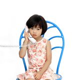 A girl and telephone Royalty Free Stock Photo