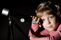 Girl and telescope Royalty Free Stock Image