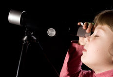 Girl with telescope Stock Photo