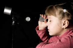 Girl with telescope royalty free stock image