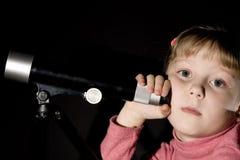 Girl and telescope stock photos
