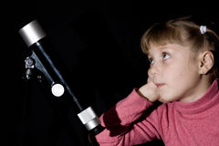 Girl and telescope royalty free stock photo