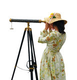 Girl with Telescope - isolated. Girl in fancy dress and hat looking through telescope - isolated Royalty Free Stock Photos