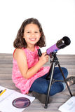 Girl telescope Stock Images