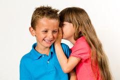 Girl telling funny story to boy Royalty Free Stock Photo