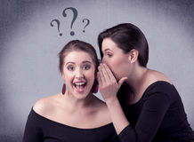 Girl telling secret things to her girlfriend Royalty Free Stock Images