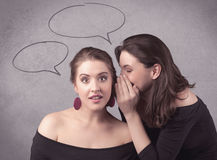 Girl telling secret things to her girlfriend Royalty Free Stock Photo