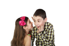 Girl telling secret to boy Royalty Free Stock Photo