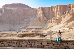 The girl with the temple in Luxor, Egypt. Panorama of famous ancient temple of Hatshepsut in Luxor, Egypt Stock Photo