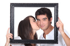Girl tenderly kissing a man Royalty Free Stock Image