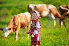 Girl tending cows Royalty Free Stock Photos