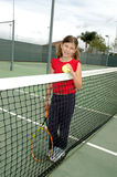 Girl tennis 2. Gril in red at tennis net stock images