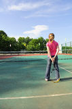The girl on a tennis court Stock Photography