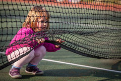 Girl on the tennis court Stock Photography