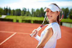 Girl on tennis court with racket Royalty Free Stock Photography