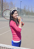 A girl on tennis ground royalty free stock photo