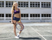 Girl tennis player standing at net Stock Photos