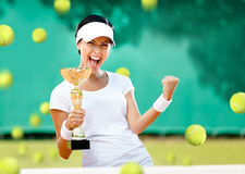 Girl tennis player won the competition. Girl tennis player won the cup at the sport competition. The joy of victory Royalty Free Stock Images