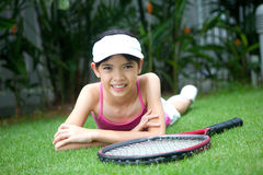 Girl with a tennis racket Stock Image