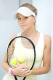 Girl with a tennis racket stock photo