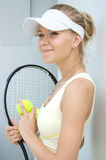 Girl with a tennis racket Royalty Free Stock Image