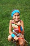 Girl with tennis racket Stock Image