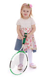 Girl with tennis racket Stock Images