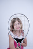 Girl with tennis racket. Little Girl with tennis racket looking at the camera Stock Images
